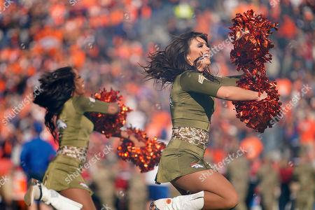 The Denver Broncos cheerleaders perform during the first half of NFL football game against the Cleveland Browns, in Denver