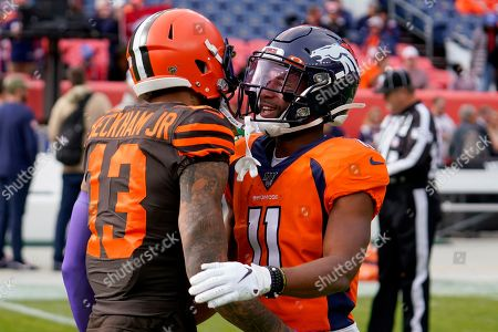Denver Broncos wide receiver Diontae Spencer (11) greets Cleveland Browns wide receiver Odell Beckham (13) prior to an NFL football game against the Cleveland Browns, in Denver