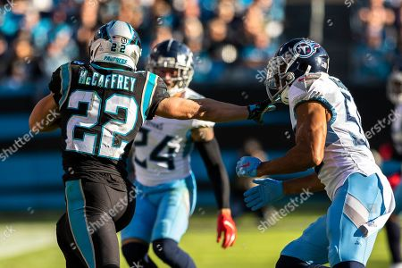 Carolina Panthers running back Christian McCaffrey (22) keeps distance from Tennessee Titans inside linebacker Wesley Woodyard (59) in the NFL matchup at Bank of America Stadium in Charlotte, NC