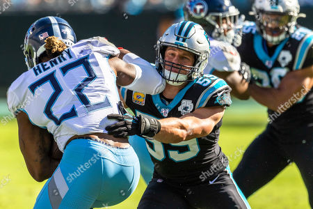 Tennessee Titans running back Derrick Henry (22) gets wrapped up by Carolina Panthers middle linebacker Luke Kuechly (59) in the NFL matchup at Bank of America Stadium in Charlotte, NC