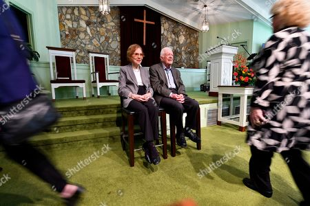 Former U.S. President Jimmy Carter and former first lady Rosalynn Carter, left, sit as guests of Maranatha Baptist Church come to have their photo made with them, after Jimmy taught Sunday school there, in Plains, Ga