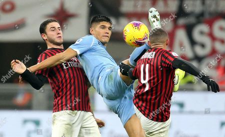 Stock Image of Lazio's Joaquin Correa (C) in action against AC Milan's Davide Calabria  (L) and Ismael Bennacer during the Italian serie A soccer match between AC Milan and SS Lazio at Giuseppe Meazza stadium in Milan, Italy, 03 November 2019.