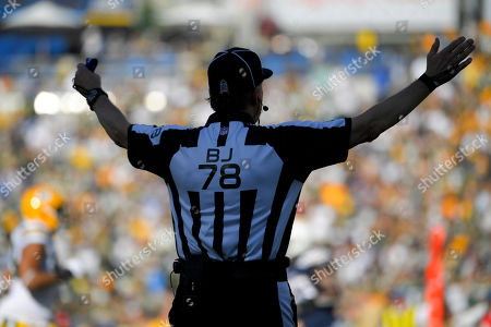 Back judge Greg Meyer (78) makes a call during the first half of an NFL football game between the Los Angeles Chargers and the Green Bay Packers, in Carson, Calif
