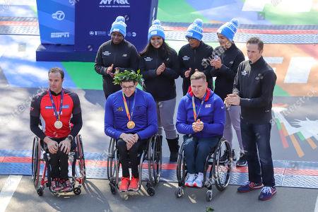 Stock Image of Second place winner, Marcel Hug,first place winner Daniel Romanchuk and third place winner David Weir celebrate