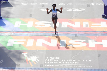Mary Keitany of Kenya arrives in second place