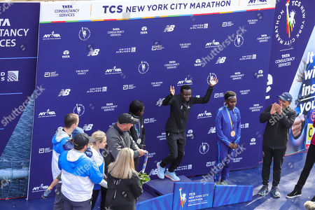 Stock Photo of Mary Keitany of Kenya, Joyciline Jepkosgei of Kenya, and Ruti Aga of Kenya pose with the trophy after taking the top three spots in the Women's Division