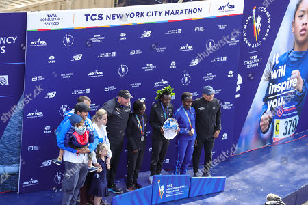 Stock Image of Mary Keitany of Kenya, Joyciline Jepkosgei of Kenya, and Ruti Aga of Kenya pose with the trophy after taking the top three spots in the Women's Division