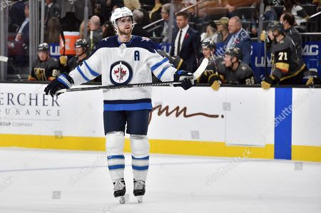 Winnipeg Jets defenseman Josh Morrissey (44) looks on against the Vegas Golden Knights during the third period of an NHL hockey game, in Las Vegas