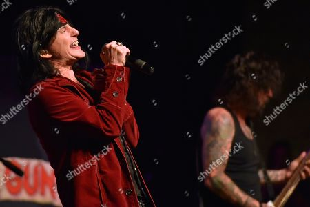 Tracii Guns, Phil Lewis. Phil Lewis, left, and Tracii Guns of L.A. Guns perform at the Arcada Theatre, in St. Charles, Ill