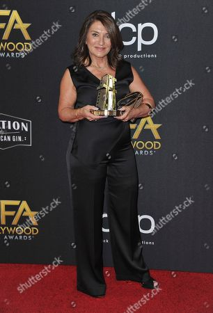 Elizabeth Yianni-Georgiou, winner of the Hollywood make-up and hairstyling award, arrives at the 23rd annual Hollywood Film Awards, at the Beverly Hilton Hotel in Beverly Hills, Calif