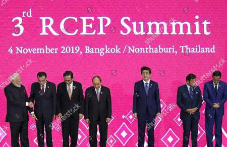 (L-R) India's Prime Minister Narendra Modi, China's Premier Li Keqiang, Thailand's Prime Minister Prayut Chan-o-cha, Vietnam's Prime Minister Nguyen Xuan Phuc, Japan's Prime Minister Shinzo Abe, Sultan of Brunei Hassanal Bolkiah and Indonesia's President Joko Widodo pose for the group photos during the 3rd RCEP (Regional Comprehensive Economic Partnership) Summit, as part of the 35th Association of Southeast Asian Nations (ASEAN) Summit at IMPACT Muang Thong Thani, a northern suburb of Bangkok in Nonthaburi province, Thailand, 04 November 2019. Thailand is hosting the 35th ASEAN Summit, which will run from 02 to 04 November 2019.