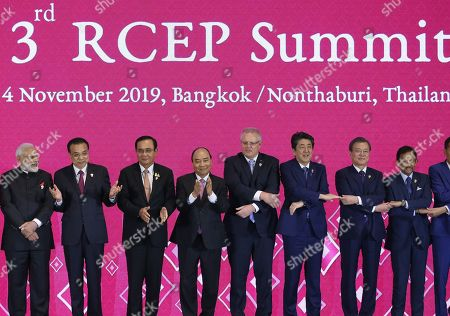 (L-R) India's Prime Minister Narendra Modi, China's Premier Li Keqiang, Thailand's Prime Minister Prayut Chan-o-cha, Vietnam's Prime Minister Nguyen Xuan Phuc, Prime Minister of Australia Scott Morrison, Japan's Prime Minister Shinzo Abe, South Korea's President Moon Jae-in and Sultan of Brunei Hassanal Bolkiah pose for a group photo during the 3rd RCEP (Regional Comprehensive Economic Partnership) Summit as part of the 35th Association of Southeast Asian Nations (ASEAN) Summit at IMPACT Muang Thong Thani, a northern suburb of Bangkok in Nonthaburi province, Thailand, 04 November 2019. Thailand is hosting the 35th ASEAN Summit, which will run from 02 to 04 November 2019.