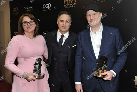 """Victoria Alonso, Mark Ruffalo, Kevin Feige. Victoria Alonso, left, and Kevin Feige, winners of the Hollywood blockbuster award for """"Avengers: Endgame,"""" pose with presenter Mark Ruffalo backstage at the 23rd annual Hollywood Film Awards, at the Beverly Hilton Hotel in Beverly Hills, Calif"""