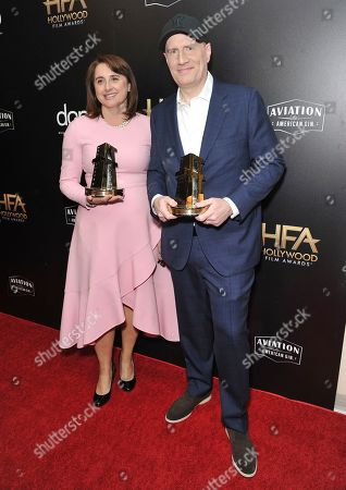 """Victoria Alonso, Kevin Feige. Victoria Alonso, left, and Kevin Feige, winners of the Hollywood blockbuster award for """"Avengers: Endgame,"""" pose backstage at the 23rd annual Hollywood Film Awards, at the Beverly Hilton Hotel in Beverly Hills, Calif"""