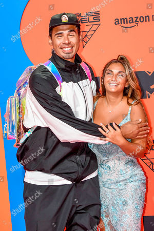 Stock Photo of DJ Afrojack and Elettra Miura Lamborghini