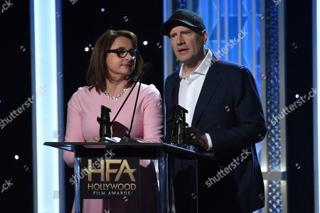"""Victoria Alonso, Kevin Feige. Victoria Alonso, left, and Kevin Feige accept the Hollywood blockbuster award for """"Avengers: Endgame"""" at the 23rd annual Hollywood Film Awards, at the Beverly Hilton Hotel in Beverly Hills, Calif"""