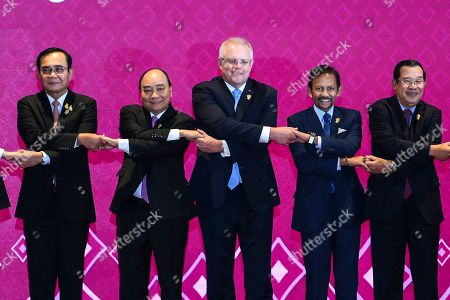 Stock Photo of (L-R) Prime Minister of Thailand Prayut Chan-o-cha, Prime Minister of Vietnam Nguyen Xuan Phuc, Prime Minister of Australia Scott Morrison, Sultan of Brunei Hassanal Bolkiah, and Prime Minister of Cambodia Hun Sen pose for a family photo during the 14th East Asia Summit at the 35th Association of Southeast Asian Nations (ASEAN) Summit at IMPACT Muang Thong Thani in Nonthaburi province, Thailand, 04 November 2019. Thailand is hosting the 35th ASEAN Summit, which will run from 02 to 04 November 2019.