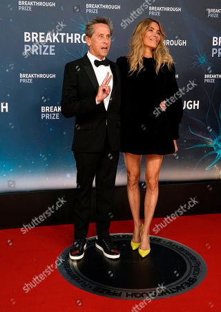 US Film Producer Brian Grazer (L) and his wife Veronica Grazer (R) pose on the red carpet before the eighth annual Breakthrough Prize Awards, held at the NASA Ames Research Center in Mountain View, California, USA, 03 November 2019. The Breakthrough Prize is awarded annually, and recognizes the world's top scientists. Considered the world's most generous science prize, each Breakthrough Prize is three million US dollar and presented in the fields of Life Sciences (up to four per year), Fundamental Physics (one per year) and Mathematics (one per year).