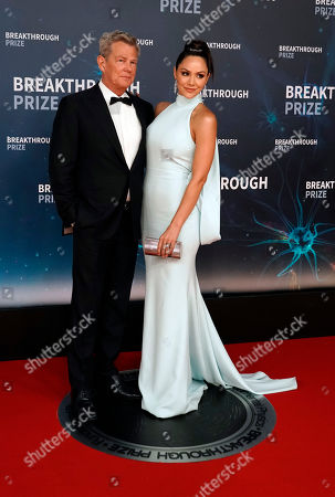 Canadian musician David Foster (L) and US actress and singer Katharine McPhee (R) pose on the red carpet before the eighth annual Breakthrough Prize Awards, held at the NASA Ames Research Center in Mountain View, California, USA, 03 November 2019. The Breakthrough Prize is awarded annually, and recognizes the world's top scientists. Considered the world's most generous science prize, each Breakthrough Prize is three million US dollar and presented in the fields of Life Sciences (up to four per year), Fundamental Physics (one per year) and Mathematics (one per year).