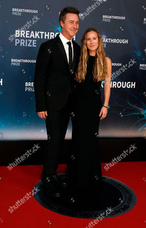 US actor Ed Norton (L) and his wife film producer Shauna Robertson (R) pose on the red carpet before the eighth annual Breakthrough Prize Awards, held at the NASA Ames Research Center in Mountain View, California, USA, 03 November 2019. The Breakthrough Prize is awarded annually, and recognizes the world's top scientists. Considered the world's most generous science prize, each Breakthrough Prize is three million US dollar and presented in the fields of Life Sciences (up to four per year), Fundamental Physics (one per year) and Mathematics (one per year).
