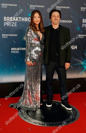 Sergey Brin, Breakthrough Prize Co-Founder and Co-Founder of Google (R) and his wife Nicole Shanahan (L) pose on the red carpet before the eighth annual Breakthrough Prize Awards, held at the NASA Ames Research Center in Mountain View, California, USA, 03 November 2019. The Breakthrough Prize is awarded annually, and recognizes the world's top scientists. Considered the world's most generous science prize, each Breakthrough Prize is three million US dollar and presented in the fields of Life Sciences (up to four per year), Fundamental Physics (one per year) and Mathematics (one per year).