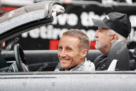 Australian jockey Damien Oliver reacts to protesters during the Melbourne Cup Parade in Melbourne, 04 November 2019. The parade showcases jockeys, trainers and horse racing identities ahead of tomorrow's running of the 2019 Melbourne Cup.