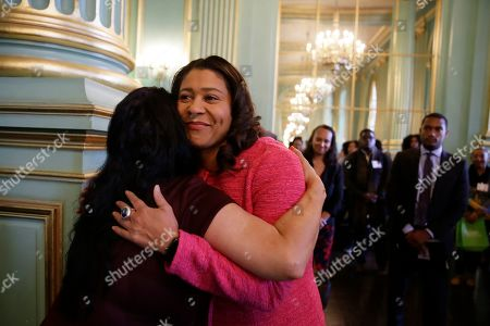 Stock Image of San Francisco Mayor London Breed is embraced before speaking at the annual Women In Construction Expo in San Francisco. San Francisco's mayor faces easy re-election in Tuesday's election but a hefty list of problems to solve, including a homelessness crisis, drug epidemic and a housing shortfall. The former president of the Board of Supervisors narrowly won a special June 2018 election to fill the seat left vacant by the sudden death of Mayor Ed Lee