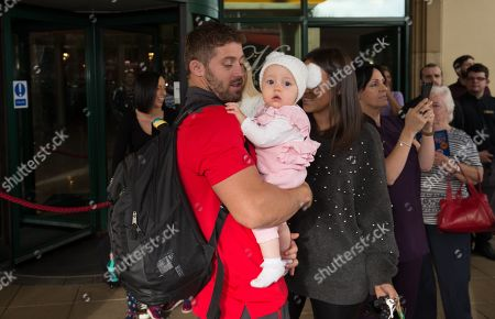 Leigh Halfpenny is reunited with his family as the Wales World Cup rugby squad arrive back at the Vale Hotel from Japan