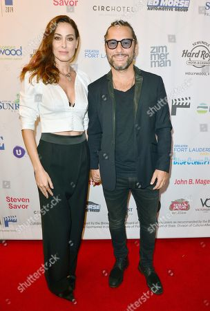 Diego Torres and wife Debora Bello (L)