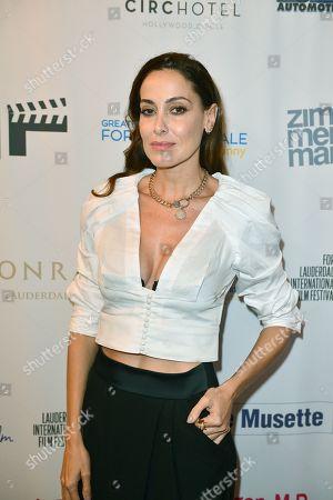 Debora Bello (L) wife of Diego Torres