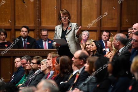 In this handout image provided by the House of Commons, one of the candidates for the role of Speaker of the House, Harriet Harman, speaks in the House of Commons, London, . British lawmakers were electing a new House of Commons speaker on Monday, with the seven contenders promising to bring a period of calm after the tempestuous tenure of the influential but controversial John Bercow