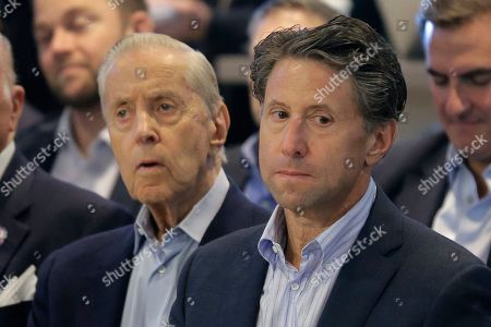 New York Mets owners Fred, left, and Jeff Wilpon attend a news conference at Citi Field, in New York. Carlos Beltran, two years removed from his playing career and with no managerial experience, has been picked by the New York Mets to replace Mickey Callaway