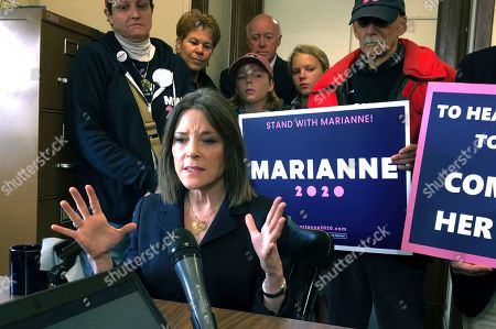 Democratic presidential candidate author Marianne Williamson speaks to the media after she filed to be listed on the ballot for the New Hampshire primary, in Concord, N.H