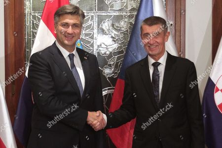 Czech Prime Minister Andrej Babis (R) and Croatian Prime Minister Andrej Plenkovic (L) shake hands during a welcome ceremony prior to their talks in Prague, Czech Republic, 04 November 2019.