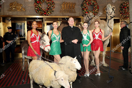 Editorial image of Cardinal Dolan And The Radio City Rockettes as The Camels, Sheep & Donkey Arrive For Their First Day Of Rehearsals For Their Starring Role In The 2019 Christmas Spectacular Starring the Radio City Rockettes Presented By Chase - 04 Nov 2019