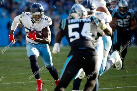 Tennessee Titans running back Derrick Henry (22) runs against the Carolina Panthers during the second half of an NFL football game in Charlotte, N.C