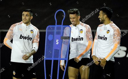 Valencia's (L-R); Maxi Gomez, Gabriel Paulista and Ezequiel Garay; attend a training session in Valencia, eastern Spain, 04 November 2019. Valencia CF will face Lille OSC in the UEFA Champions League group stage soccer match at Mestalla stadium on 05 November 2019.