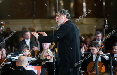 Argentinian conductor Jose Cura leads the Hungarian Radio Symphony Orchestra and Choir during a concert held on the national day of mourning to mark the 63rd anniversary of the Soviet invasion that crushed Hungary's 1956 revolution and war of independence against communist rule and the Soviet Union in St. Stephen?s Cathedral in Budapest, Hungary, 04 November 2019.