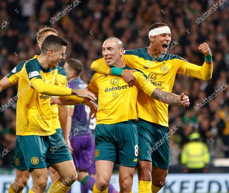 Celtic captain Scott Brown celebrates with team mates Tom Rogic & Christopher Jullien after scoring to give them a 1-4 lead.
