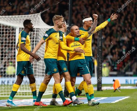 Stock Photo of Celtic captain Scott Brown celebrates with team mates Odsonne Edouard, Kristoffer Ajer, Tom Rogic & Christopher Jullien after scoring to give them a 4-1 lead.