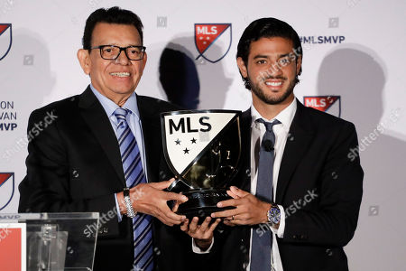 Fernando Valenzuela, former Los Angeles Dodgers Los Angeles pitcher poses with FC's Carlos Vela with the most valuable player trophy of Major League Soccer, in Los Angeles. Vela had 34-goal regular season goals and 15 assists during a dominant second season with LAFC. The former Real Sociedad forward joined the expansion MLS club as its first player in early 2018