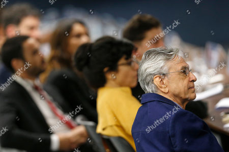 Stock Photo of Brazilian singer Caetano Veloso, right, attends a public hearing on the freedom of artistic expression at the Supreme Court headquarters in Brasilia, Brazil, . Newspaper columnists and celebrated artists are saying that President Jair Bolosonaro's cultural conservatism may lead to routine censorship and public money drying up for progressive artistic projects