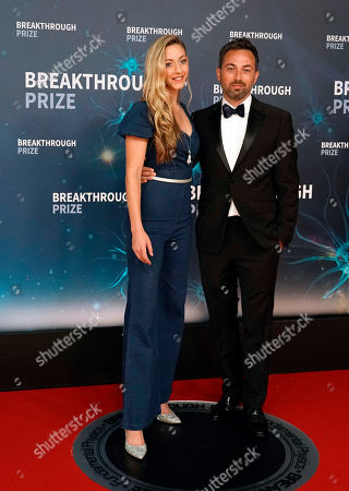 Australian Derek Muller (R) and an unknown guest (L) on the red carpet before the eighth annual Breakthrough Prize Awards held at the NASA Ames Research Center in Mountain View, California, USA, 03 November 2019 (Issued 06 November 2019). The Breakthrough Prize is awarded annually, and recognizes the world's top scientists. Considered the world's most generous science prize, each Breakthrough Prize is three million dollars and presented in the fields of Life Sciences (up to four per year), Fundamental Physics (one per year) and Mathematics (one per year).