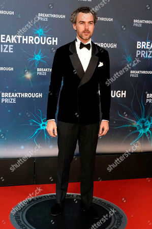 Stock Photo of Gian Luca Passi de Preposulo (C) an Italian noble family member, on the red carpet before the eighth annual Breakthrough Prize Awards held at the NASA Ames Research Center in Mountain View, California, USA, 03 November 2019 (Issued 06 November 2019). The Breakthrough Prize is awarded annually, and recognizes the world's top scientists. Considered the world's most generous science prize, each Breakthrough Prize is three million dollars and presented in the fields of Life Sciences (up to four per year), Fundamental Physics (one per year) and Mathematics (one per year).