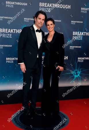 Philipp Schindler (L) Chief Business Officer of Google, and his wife Andrea Wilms (R) on the red carpet before the eighth annual Breakthrough Prize Awards held at the NASA Ames Research Center in Mountain View, California, USA, 03 November 2019 (Issued 06 November 2019). The Breakthrough Prize is awarded annually, and recognizes the world's top scientists. Considered the world's most generous science prize, each Breakthrough Prize is three million dollars and presented in the fields of Life Sciences (up to four per year), Fundamental Physics (one per year) and Mathematics (one per year).