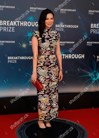 Stock Image of Entrepreneur Wendi Deng Murdoch (C) on the red carpet before the eighth annual Breakthrough Prize Awards held at the NASA Ames Research Center in Mountain View, California, USA, 03 November 2019 (Issued 06 November 2019). The Breakthrough Prize is awarded annually, and recognizes the world's top scientists. Considered the world's most generous science prize, each Breakthrough Prize is three million dollars and presented in the fields of Life Sciences (up to four per year), Fundamental Physics (one per year) and Mathematics (one per year).