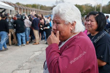 Sally Taylor, left, and Sarah Taylor, right, wait for their granddaughter and niece, Tess Harjo, to walk out of Eddie Warrior Correctional Center in Taft, Okla