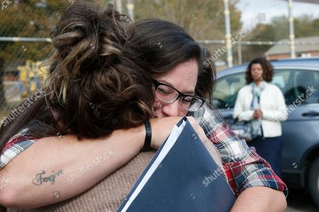 Danni Sloane Roberts, Sydney Roberts. Danni Sloan Roberts, right, embraces her sister Sydney Roberts, left, after being released from the Eddie Warrior Correctional Center in Taft, Okla. More than 450 inmates walked out the doors of prisons across Oklahoma on Monday as part of what state officials say is the largest single-day mass commutation in U.S. history