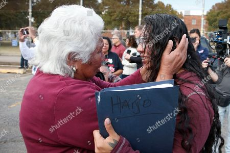 Stock Picture of Sally Taylor, Tess Harjo. Sally Taylor, left, embraces her granddaughter Tess Harjo, right, after Harjo was released from the Eddie Warrior Correctional Center, in Taft, Okla. More than 450 inmates walked out the doors of prisons across Oklahoma on Monday as part of what state officials say is the largest single-day mass commutation in U.S. history