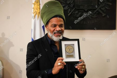 Brazilian singer, percussionist, composer and music producer Carlinhos Brown, receives the distinction of 'Illustrious Visitor' by the Municipality of Montevideo, Uruguay, 04 November 2019. Carlinhos Brown celebrated the 'strengthening' of the drum culture in Uruguay after being named 'illustrious visitor' of Montevideo for his collaboration with social organizations, schools, cultural projects and children.
